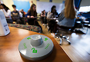A YONDR pouch unlocking device sits at the front of an Algebra 2 / Trigonometry class at West High School in Madison, WI on Friday, April 12, 2019.