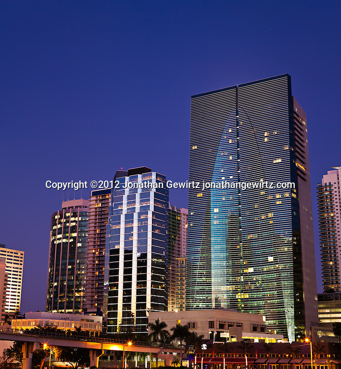 Vertical panorama showing several office buildings and condos on and adjacent to Miami's Brickell Avenue at night. WATERMARKS WILL NOT APPEAR ON PRINTS OR LICENSED IMAGES.