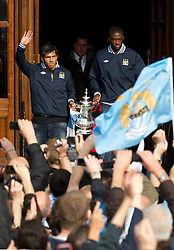© licensed to London News Pictures. Manchester, UK  23/05/2011. Carlos Tevez (left) & Kaya Torre (right). Tens of thousands of fans line the streets of Manchester as Manchester City Football Club hold an open-topped bus parade through the city. The team are celebrating winning the FA Cup, their first trophy in 35 years, and for qualifying for next season's Champions League. Please see special instructions for usage rates. Photo credit should read Joel Goodman/LNP