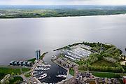 Nederland, Flevoland, Almere, 07-05-2015;  Almere-Haven met naast de jachthaven de flat Golvend land, Gooimeer richting Huizen in de achtergrond.<br /> New town Almere-harbour.<br /> luchtfoto (toeslag op standard tarieven);<br /> aerial photo (additional fee required);<br /> copyright foto/photo Siebe Swar