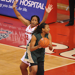 Jan 31, 2009; Piscataway, NJ, USA; Rutgers center Rashidat Junaid (43) defends against South Florida center Jessica Lawson (23) during the second half of South Florida's 59-56 victory over Rutgers in NCAA women's college basketball at the Louis Brown Athletic Center