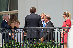 United States President Donald J. Trump, center, arrives to look at the partial eclipse of the sun from the Blue Room Balcony of the White House in Washington, DC on Monday, August 21, 2017.  Pictured from left to right: US Attorney General Jeff Sessions, first lady Melania Trump, Barron Trump, United States Trade Representative Robert E. Lighthizer, President Trump, US Secretary of Commerce Wilbur Ross, and Ivanka Trump.<br /> Credit: Ron Sachs / CNP