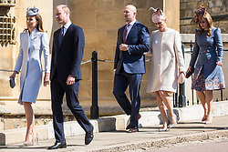 Windsor, UK. 21st April 2019. The Duke and Duchess of Cambridge, Mike and Zara Tindall and Princess Beatrice arrive to attend the Easter Sunday service at St George's Chapel in Windsor Castle.