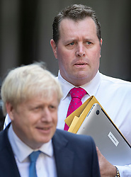 © Licensed to London News Pictures. 23/07/2019. London, UK. Mark Spencer MP (R) , new chief whip, walks with newly elected Conservative Party leader Boris Johnson at party headquarters after attending a reception. Photo credit: Peter Macdiarmid/LNP