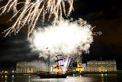 © Licensed to London News Pictures. 28/08/2013. Fireworks illuminate the night sky at Greenwich with the Old Royal Naval College behind and a tall ship sailing past. The fireworks were launched on the river as part of the Sail Royal Greenwich tall ships event. credit : Mike King/LNP