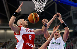 Marcin Gortat of Poland vs Primoz Brezec (7) of Slovenia  during the EuroBasket 2009 Group F match between Slovenia and Poland, on September 14, 2009 in Arena Lodz, Hala Sportowa, Lodz, Poland.  (Photo by Vid Ponikvar / Sportida)