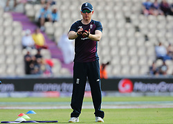 England Captain Eoin Morgan warms up with the team despite having a fractured left index finger during the ICC Cricket World Cup Warm up match at The Hampshire Bowl, Southampton.