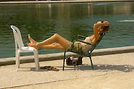 Paris - France -Jardin des Tuileries - women sunbathing.
