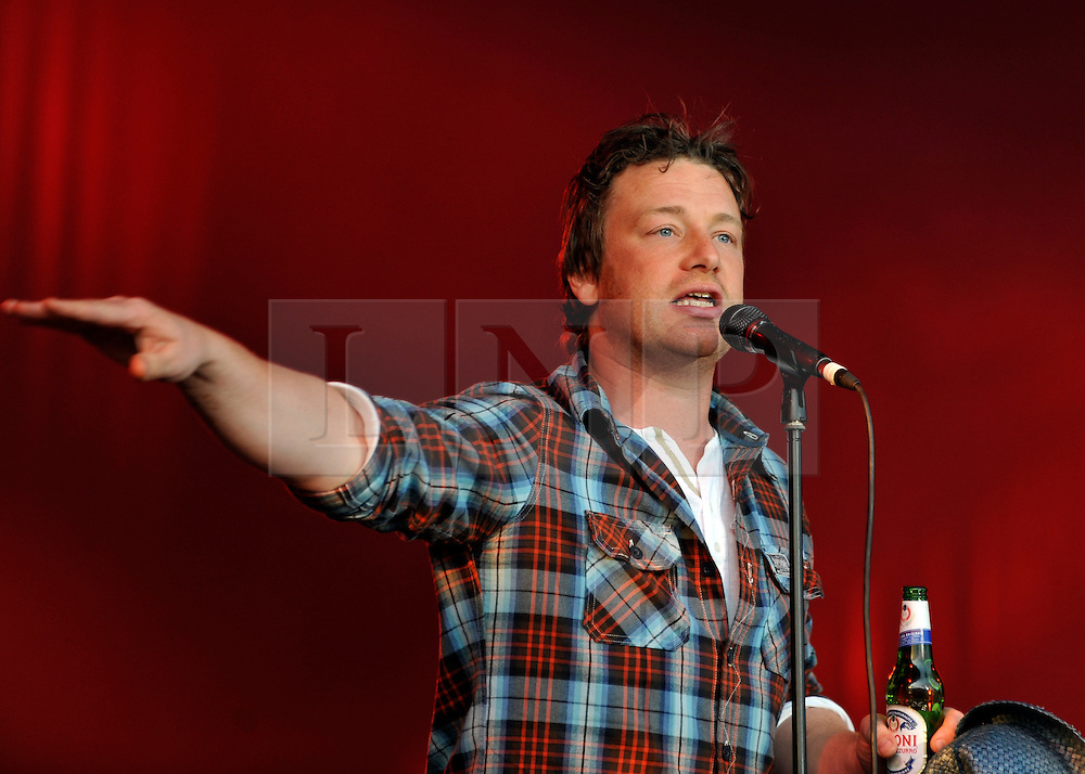 © licensed to London News Pictures. LONDON. UK.  02/07/11. Jamie Oliver introduces The Charlatans headline act of day two  of The Big Feastival in Clapham Common. Jamie Oliver's The Big Feastival, is a three day event featuring food from some of the country's top chefs along with live music. The Big Feastival takes place on Clapham Common on the 1st, 2nd and 3rd July. All profits from the event will be shared between The Jamie Oliver Foundation and The Prince's Trust.  Mandatory Credit Stephen Simpson/LNP