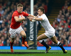 Gareth Anscombe of Wales under pressure from Henry Slade of England<br /> <br /> Photographer Simon King/Replay Images<br /> <br /> Six Nations Round 3 - Wales v England - Saturday 23rd February 2019 - Principality Stadium - Cardiff<br /> <br /> World Copyright © Replay Images . All rights reserved. info@replayimages.co.uk - http://replayimages.co.uk