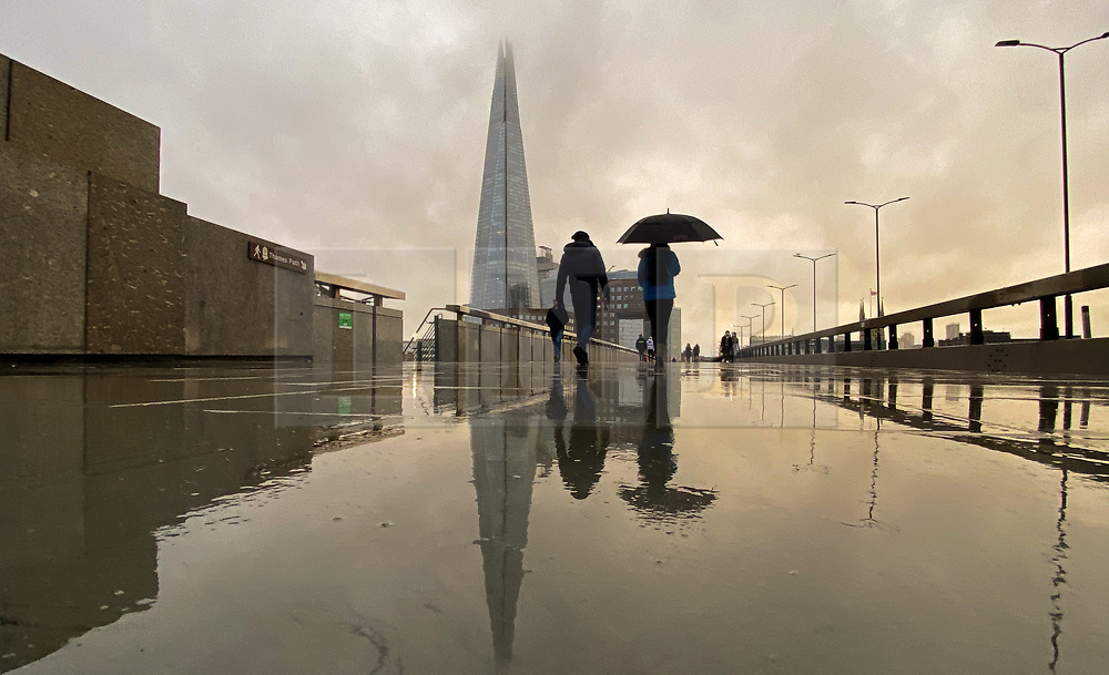 © Licensed to London News Pictures. 13/12/2020. London, UK. Reflection of The Shard on a wet pavement caused by rainfall in the capital. Photo credit: Dinendra Haria/LNP