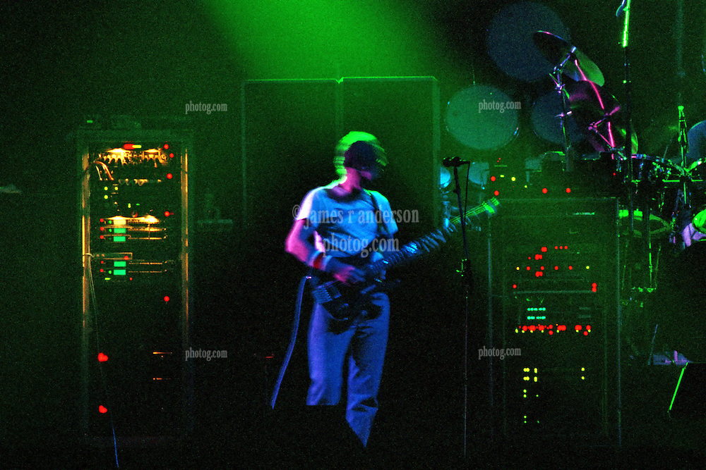 """Phil Lesh performing with The Grateful Dead Live at The Hampton Coliseum on 8 October 1989. One of the """"Formerly The Warlocks"""" concerts. Image capture during """"Dark Star"""". Limited Edition Photographic Prints available for purchase in Cart."""