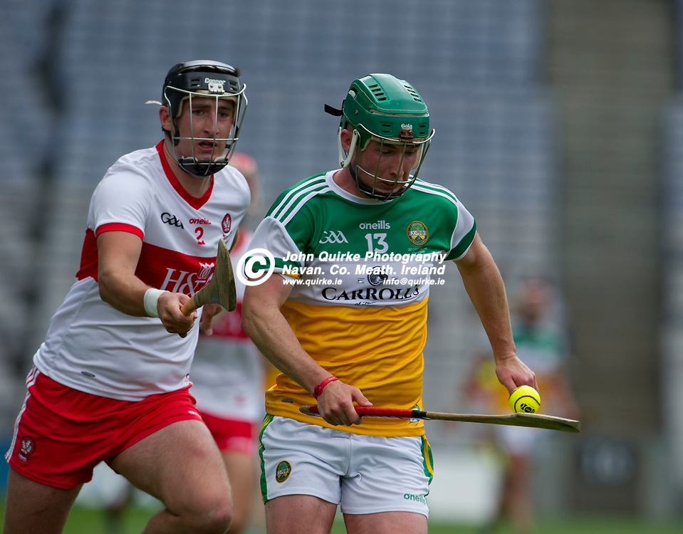 01–08-21.<br /> Derry v Offaly - Christy Ring Cup Final at Croke Park.<br /> Jason Sampson, Offaly in action against Meehaul McGrath, Derry in the Christy Ring Cup Final.<br /> Photo: the John Quirke / www.quirke.ie<br /> ©John Quirke Photography, 16 Proudstown Road, Navan. Co. Meath. (info@quirke.ie / 046-9028461 / 087-2579454).