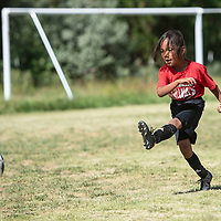 Liam Weber-Jones, 6, participates in shooting drills  Thursday morning at St. Michael Indian School summer soccer Cardinal Camp in St. Michaels, Arizona.