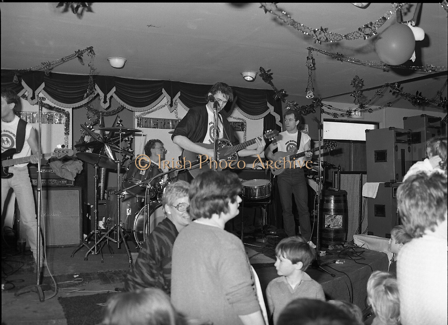 Christmas Party With Johnny Logan..1986..16.12.1986..12.16.1986..16th December 1986..At the 'Embankment',Tallaght, a charity Christmas Party was held for deprived children of the area. The main attraction was the singer and entertainer Johnny Logan,who with his band,entertained the children. Santa Claus took time off from his busy schedule to give a present to all the boys and girls. A great time was had by all...Image shows Johnny has all the children up dancing and joining in the fun.Some parents and minders are also seen joining in.
