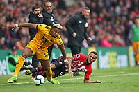 Football - 2018 / 2019 Premier League - Southampton vs. Wolverhampton Wanderers<br /> <br /> Southampton's Ryan Bertrand tries to stop Adama Traore of Wolverhampton Wanderers during the Premier League match at St Mary's Stadium Southampton <br /> <br /> COLORSPORT/SHAUN BOGGUST