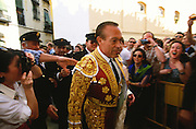 """Curro Romero's debut in Madrid happened on July 18, 1957, a controversial matador with a career that spanned decades was known for both great triumphs and equally monumental failures. The fans often came armed with rolls of toilet paper to throw at him, anticipating failure in advance. As the saying went, though, """"It is worth seeing and jeering Curro Romero on twenty bad afternoons, just to catch him on that one good day."""" On a """"good day"""" where the mood suited him, there was no one more graceful, daring, or artistic. Like Dr. Jekyll and Mr. Hyde, Romero was a """"split personality"""" as far as bullfighting went, but such is the stuff legends are made from """"El vití""""...Bullfighting in Sevilla's famous bullring """"La Real Maestranza"""" is a significant part of the Feria de Abril..The Feria de abril de Sevilla, """"Seville April Fair"""" dates back to 1847. During the 1920s, the feria reached its peak and became the spectacle that it is today. It is held in the Andalusian capital of Seville in Spain. The fair generally begins two weeks after the Semana Santa, Easter Holy Week. The fair officially begins at midnight on Monday, and runs six days, ending on the following Sunday. Each day the fiesta begins with the parade of carriages and riders, at midday, carrying Seville's citizens to the bullring, La Real Maestranza...For the duration of the fair, the fairgrounds and a vast area on the far bank of the Guadalquivir River are covered in rows of casetas (individual decorated marquee tents which are temporarily built on the fairground). Some of these casetas belong to the prominent families of Seville, some to groups of friends, clubs, trade associations or political parties. From around nine at night until six or seven the following morning, at first in the streets and later only within each caseta, crowds of people party and dance Sevillanas, traditional Flamenco dances, Sevillan style drinking Jerez sherry, or Manzanilla wine, and eating tapas. .."""