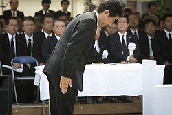 August 9, 2016 - Nagasaki, Nagasaki Prefecture, Japan - NAGASAKI, JAPAN - AUGUST 9 : Japanese Prime Minister Shinzo Abe bow after address speech during the 71st Anniversary of atomic bombing on Nagasaki at Nagasaki Peace Park, Nagasaki, southern Japan, Tuesday, August 9, 2016. Japan marked the 71st anniversary of the atomic bombing on Nagasaki. On August 9, 1945, during World War II, the United States dropped the second Atomic bomb on Nagasaki city, killing an estimated 40,000 people which ended World War II. (Credit Image: © Richard Atrero De Guzman/NurPhoto via ZUMA Press)