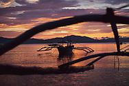 Traditional bangka boats at sunset in Port Barton, Palawan, Philippines.