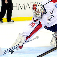 Washington Capitals goalie Michal Neuvirth dives to his right and makes the save on Pittsburgh Penguins Sidney Crosby shot in the second period at the Consol Energy Center in Pittsburgh on February 7, 2013.   UPI/Archie Carpenter