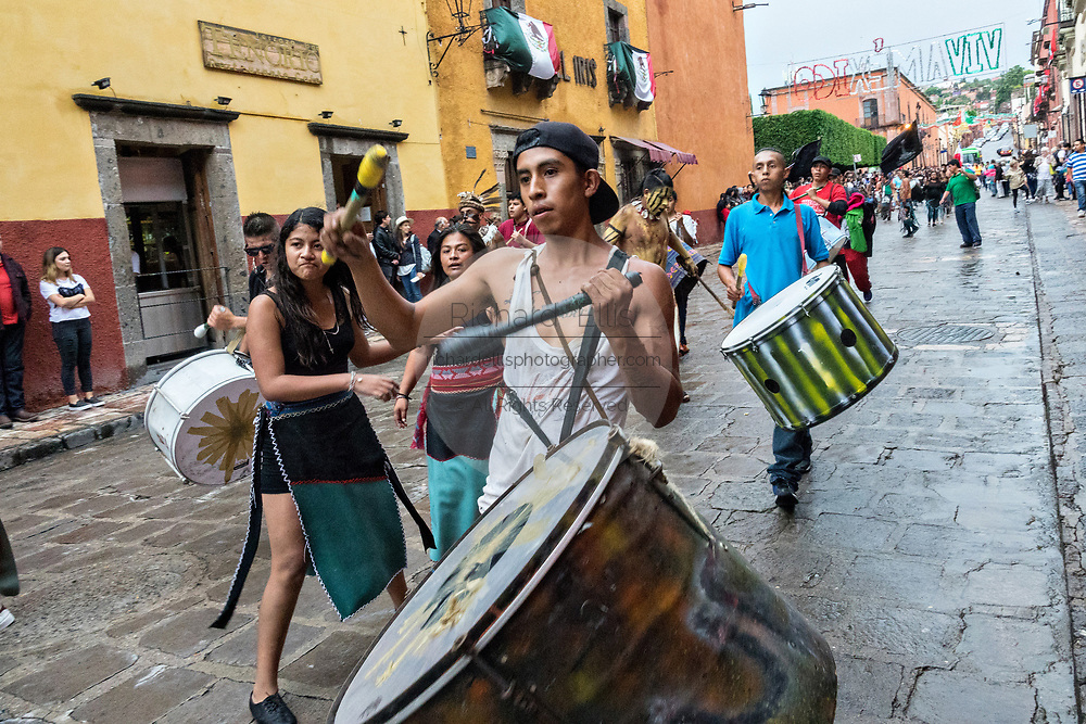 Drummers march in a procession through the historic city during the week long fiesta of the patron saint Saint Michael September 24, 2017 in San Miguel de Allende, Mexico.