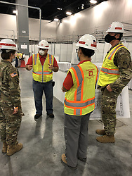 "Diana Holland, commanding general at U.S. Army Corps of Engineers, South Atlantic Division, explained: ""Amazing visit to the Miami Beach Convention Center where the Jacksonville District is building out bed spaces for potential COVID-19 patients. They are moving the project at lightning speed! Proud of this team that is working hard to save lives!""<br /> <br /> Where: Miami, Florida, United States<br /> When: 15 Apr 2020<br /> Credit: Diana Holland/US Army Corps/Cover Images<br /> <br /> **Editorial use only**"