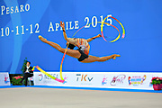 """Lopez Grisbel during ribbon routine at the International Tournament of rhythmic gymnastics """"Città di Pesaro"""", 11 April, 2015. Grisbel born on September 09,1995 in Valencia, is a Venezuelan rhythmic gymnast.<br /> This tournament dedicated to the youngest athletes is at the same time of the World Cup."""