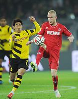 Fotball<br /> Tyskland<br /> 14.03.2015<br /> Foto: Witters/Digitalsport<br /> NORWAY ONLY<br /> <br /> v.l. Shinji Kagawa, Kevin Vogt (Koeln)<br /> Fussball Bundesliga, Borussia Dortmund - 1. FC Köln