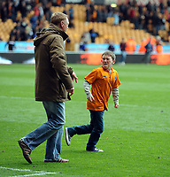 A Young and Upset Wolverhampton Wanderer Fan walks on to the pitch after the final whistle<br />