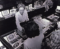 1945 Evelyn Keyes selling cigarettes and cigars at Schwab's Drugstore