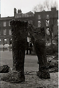 Destruction Of Wolfe Tone Statue..1971..08.02.1971..02.08.1971..8th February 1971..This morning the statue of Wolfe Tone on St Stephens Green was destroyed by explosion. The UDA (Ulster Defence Assoc) were alleged to have carried out the attack..The statue by sculptor Edward Delaney was unveiled by President Eamon DeValera on the 18 Nov 1967. Wolfe Tone ( 1763 -1798) was a leader of the 1798 Rebellion. Captured and sentenced to death by English Forces he died in prison from self inflicted wounds before the execution could be carried out..Photograph of two legs,all that remained standing after the explosion that destroyed the Wolfe Tone statue.