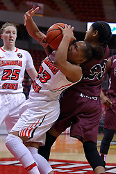 29 January 2017: Viria Livingston and Kristen Nelson wrestle for the ball during an College Missouri Valley Conference Women's Basketball game between Illinois State University Redbirds the Salukis of Southern Illinois at Redbird Arena in Normal Illinois.