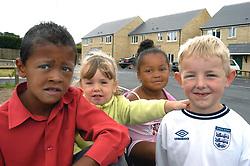 Four children playing on their Housing Association estate; Halifax; Yorkshire UK