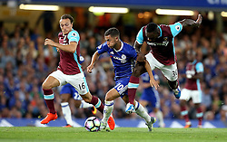 Eden Hazard of Chelsea goes past Michail Antonio and Mark Noble of West Ham United - Mandatory by-line: Robbie Stephenson/JMP - 15/08/2016 - FOOTBALL - Stamford Bridge - London, England - Chelsea v West Ham United - Premier League