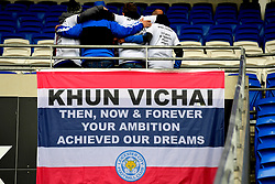 Leicester City fans above a flag remembering Vichai Srivaddhanaprabha that reads 'Khun Vichai Then, Now & Forever Your Ambition Achieved Our Dreams' during the Premier League match at the Cardiff City Stadium, Cardiff.