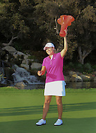 29 MAR15  Champion Christie Kerr celebrates with her trophy on 18 after Sunday's Final Round of The KIA Classic at Aviara Golf Club in LaCosta, California. (photo credit : kenneth e. dennis/kendennisphoto.com)