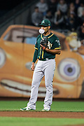 Oakland Athletics shortstop Marcus Semien (10) blows bubbles with his chewing gum during a game against the San Francisco Giants at AT&T Park in San Francisco, California, on March 26, 2018. (Stan Olszewski/Special to S.F. Examiner)