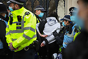 Kill the Bill demonstration in Central London against the proposed Police, Crime, Sentencing and Courts Bill on the 3rd April 2021, London, United Kingdom. A young woman is arrested in Parliament Square. After the protest ended in Parliament Square police cleared the streets, arresting several in the process. Thousands turned out in London and across the UK to show their objection to the Governments proposed bill. Many fear the bill is meant to suppress acts of protesting and demonstrations. The police will be given greater powers to prevent and stop actions of civil disobedience and peaceful protests and many see this as a suppression of their civil liberties. Sentencing for acts of peaceful protest is also likely to be much harsher and that may also act as a deterrent to protest.
