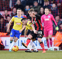 Huddersfield Town's Harry Bunn tussles for the ball with Bournemouth's Matt Ritchie - Photo mandatory by-line: Paul Knight/JMP - Mobile: 07966 386802 - 14/02/2015 - SPORT - Football - Bournemouth - Goldsands Stadium - AFC Bournemouth v Huddersfield Town - Sky Bet Championship
