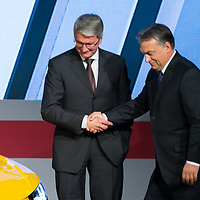 Viktor Orban (R) prime minister of Hungary and Rupert Stadler (L) Chairman of the Board of Audi Management shake hands in front of the first Audi TT Roadster after it is introduced during the official production launch event in the Audi factory in Gyor (about 120 km West of Budapest), Hungary on November 05, 2014. ATTILA VOLGYI