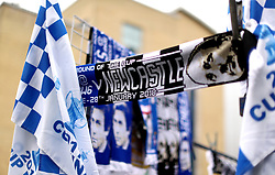 A commemorative scarf of the match on display outside the grounds of the stadium before the match begins