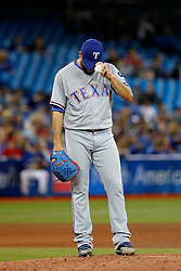 April 29, 2018 - Toronto, ON, U.S. - TORONTO, ON - APRIL 29: Texas Rangers Starting pitcher Martin Perez (33) pauses to adjust his hat during the MLB game between the New York Yankees and the Toronto Blue Jays on April 29, 2018 at Rogers Centre in Toronto, ON. (Photo by Jeff Chevrier/Icon Sportswire) (Credit Image: © Jeff Chevrier/Icon SMI via ZUMA Press)