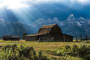 Rays of light beaming through the clouds in Grand Teton National Park.
