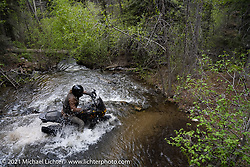Danger Dan Hardick crosses a deep and rushing mountain stream / river on his 2-week old Harley-Davidson Pan-America adventure bike just outside Red River, NM, USA. Saturday, May 29, 2021. Photography ©2021 Michael Lichter.