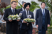 Two days after the killing of the Conservative member of parliament for Southend West, Sir David Amess MP, Wes Streeting (Labour MP for Ilford North, left with flowers) and a member of the Sikh community bring floral tributes to Eastwood Road North, a short distance from Belfairs Methodist Church in Leigh-on-Sea, on 17th October 2021, in Leigh-on-Sea, Southend , Essex, England. Amess was conducting his weekly constituency surgery when attacked with a knife by Ali Harbi Ali.
