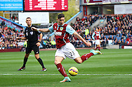Burnley's Stephen Ward shoots at goal. Barclays Premier league match, Burnley v Everton at Turf Moor in Burnley, Lancs on Sunday 26th October 2014.<br /> pic by Chris Stading, Andrew Orchard sports photography.