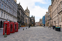 Edinburgh, Scotland, UK. 29 March, 2020. Life in Edinburgh on the first Sunday of the Coronavirus lockdown. Streets deserted, shops and restaurants closed, very little traffic on streets and reduced public transport. Pictured; The Royal Mile. Iain Masterton/Alamy Live News