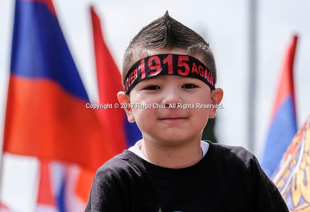 """4月24日,在美国洛杉矶,一名年轻示威者参加纪念""""亚美尼亚大屠杀""""事件102周年游行。新华社发(赵汉荣摄)<br /> A boy joins thousands of Armenians carrying signs and Armenian flags march in Los Angeles, the United States, Monday April 24, 2017, to mark the 102nd anniversary of the Armenian Genocide. (Xinhua/Zhao Hanrong)(Photo by Ringo Chiu/PHOTOFORMULA.com)<br /> <br /> Usage Notes: This content is intended for editorial use only. For other uses, additional clearances may be required."""