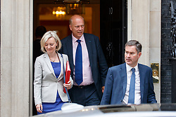 © Licensed to London News Pictures. 11/07/2017. London, UK. Chief Secretary to the Treasury LIZ TRUSS, Transport Secretary CHRIS GRAYLING and Work and Pensions Secretary DAVID GAUKE leave after a cabinet meeting in Downing Street, London on Tuesday, 11 July 2017. Photo credit: Tolga Akmen/LNP