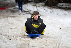 © Licensed to London News Pictures. 11/12/2017. Amersham, UK. Carl from Amersham plays in the snow in Amersham. Yesterday parts of the south east of England experienced heavy snow, with the home counties experiencing some of the worst conditions. Many schools in the area are closed today. Photo credit : Tom Nicholson/LNP